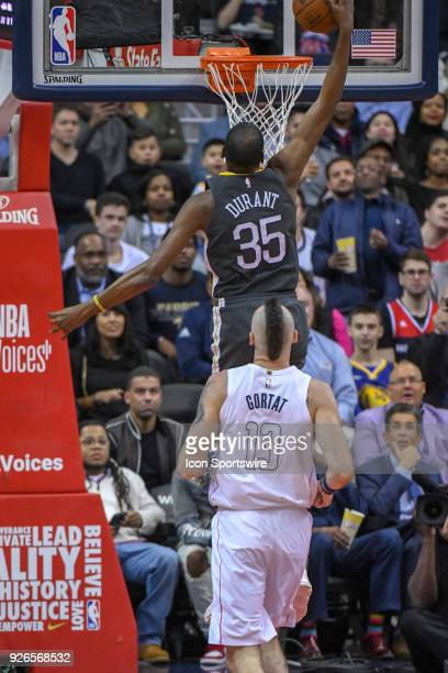 Golden State Warriors forward Kevin Durant scores on a fast break against Washington Wizards center Marcin Gortat on February 28 2018 at the Capital...