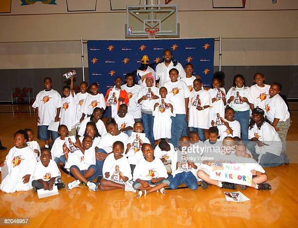 Golden State Warriors free agent signee Ronny Turiaf poses for a picture with children from a local community group at a special introductory press...