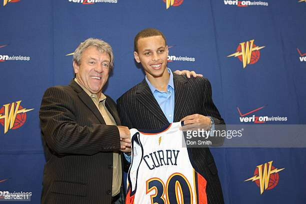 Golden State Warriors General Manager Larry Riley poses with draft pick Stephen Curry at the Warriors practice facility June 26 2009 in Oakland...