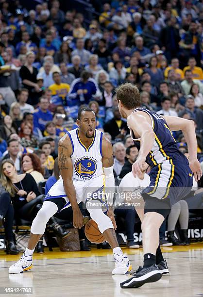 Golden State Warriors guard Andre Iguodala dribbles the ball while guarded by Utah Jazz forward Joe Ingles at ORACLE Arena on November 21, 2014 in...