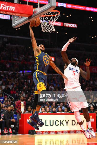 Golden State Warriors Guard Andre Iguodala goes in for a dunk over Los Angeles Clippers Center Montrezl Harrell during a NBA game between the Golden...