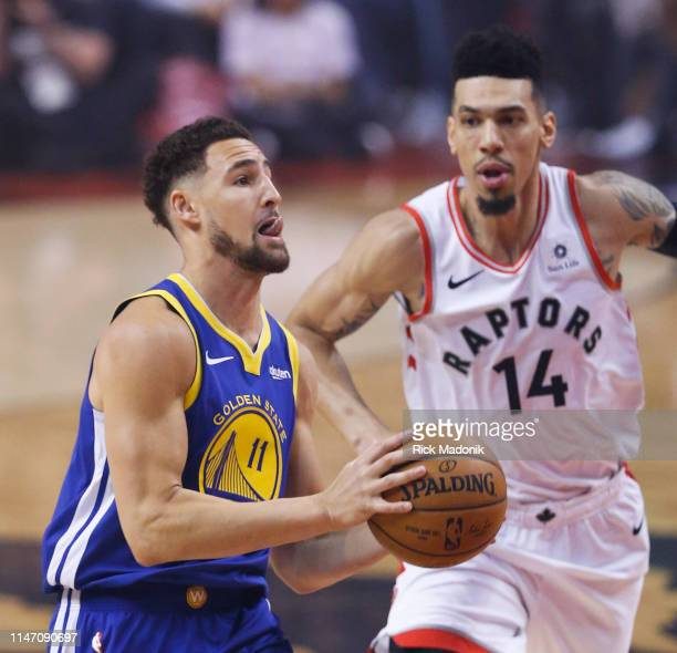 Golden State Warriors guard Klay Thompson goes to the bucket early in the game as Toronto Raptors guard Danny Green trails Toronto Raptors vs Golden...