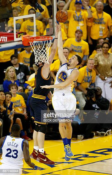 Golden State Warriors guard Klay Thompson makes a layup over Cleveland Cavaliers guard Matthew Dellavedova during the second quarter of Game 1 of the...