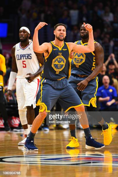 Golden State Warriors Guard Klay Thompson reacts after scoring a basket in overtime during a NBA game between the Golden State Warriors and the Los...