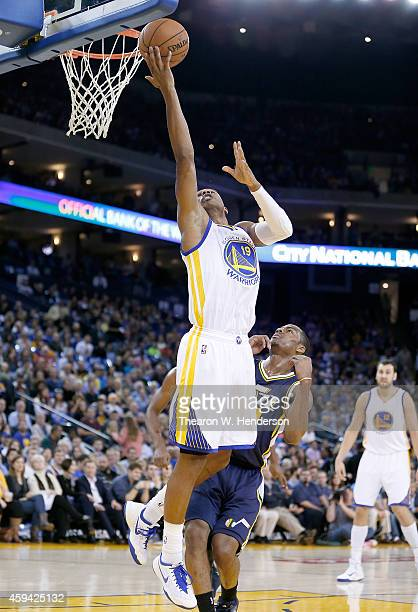 Golden State Warriors guard Leandro Barbosa goes up to shoot over Utah Jazz guard Alec Burks at ORACLE Arena on November 21 2014 in Oakland California