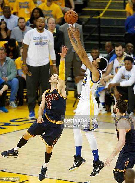Golden State Warriors guard Shaun Livingston shoots the ball over Cleveland Cavaliers guard Matthew Dellavedova during the second quarter of game 1...