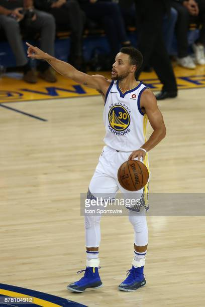 Golden State Warriors guard Steph Curry handles the ball during an NBA game against the Minnesota Timberwolves on November 08 2017 at Oracle Arena in...