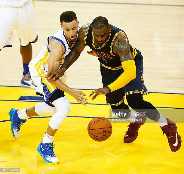 Golden State Warriors guard Stephen Curry and Cleveland Cavaliers forward LeBron James scramble for a loose ball during the second quarter of game 1...