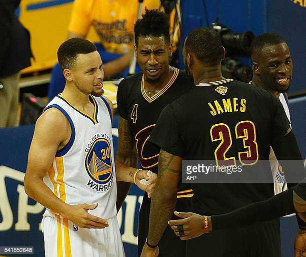 Golden State Warriors guard Stephen Curry and Cleveland Cavaliers forward LeBron James exchange words during the second quarter in Game 7 of the NBA...