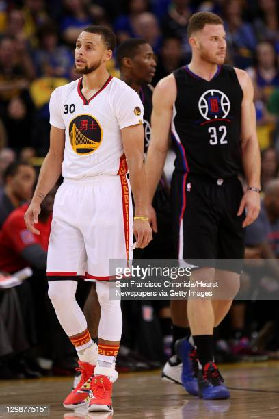 Golden State Warriors guard Stephen Curry and LA Clippers forward Blake Griffin during the first quarter of an NBA basketball game between the Golden...