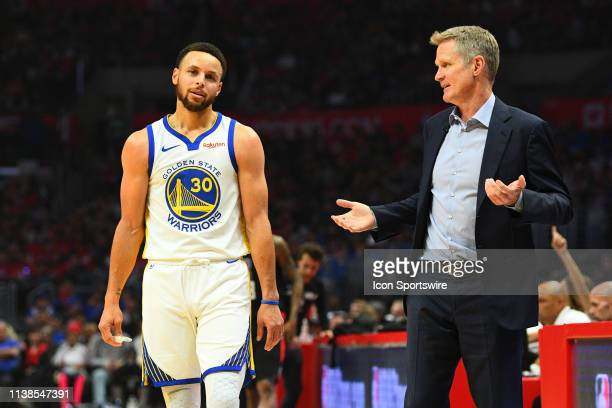 Golden State Warriors Guard Stephen Curry and head coach Steve Kerr look on during game four of the first round of the 2019 NBA Playoffs between the...