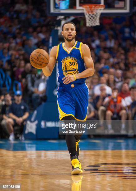 Golden State Warriors Guard Stephen Curry bringing the ball up court versus Oklahoma City Thunder on March 20 at the Chesapeake Energy Arena Oklahoma...