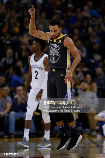 Golden State Warriors guard Stephen Curry celebrates after he made a three-point shot against Memphis Grizzlies guard Kobi Simmons during the second...