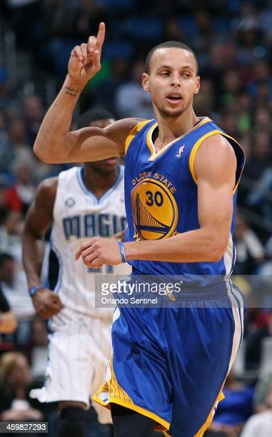 Golden State Warriors guard Stephen Curry celebrates after scoring against the Orlando Magic at the Amway Center in Orlando Fla on Tuesday Dec 31 2013