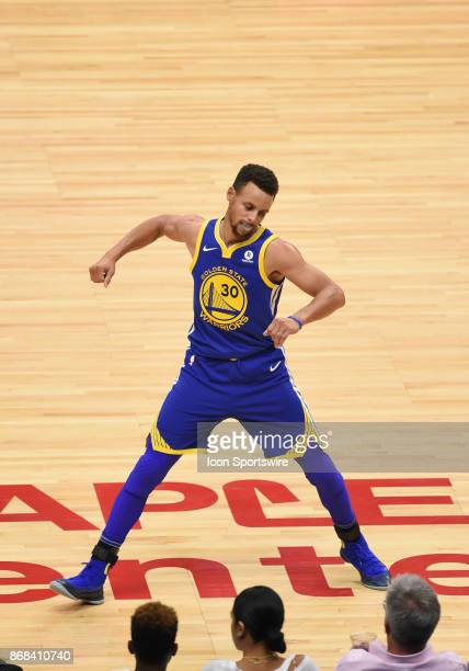 Golden State Warriors Guard Stephen Curry celebrates after shooting a three pointer during an NBA game between the Golden State Warriors and the Los...