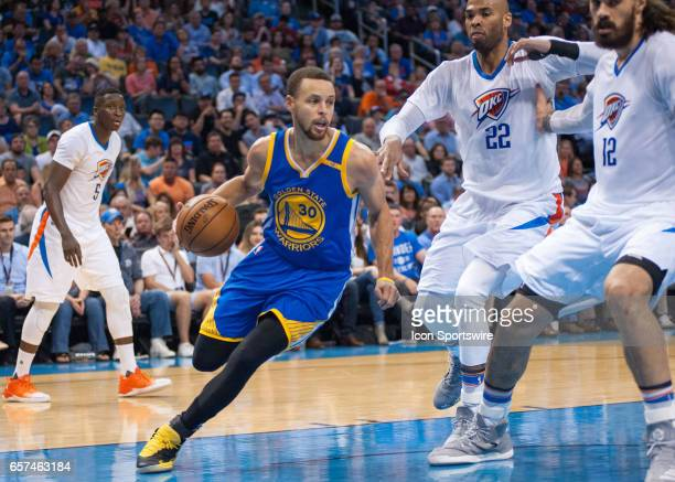 Golden State Warriors Guard Stephen Curry driving through the paint versus Oklahoma City Thunder on March 20 at the Chesapeake Energy Arena Oklahoma...