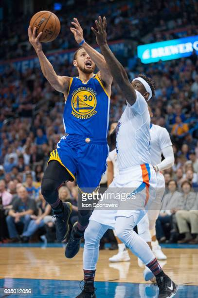 Golden State Warriors Guard Stephen Curry in the paint for a layup versus Oklahoma City Thunder on February 11 at the Chesapeake Energy Arena...