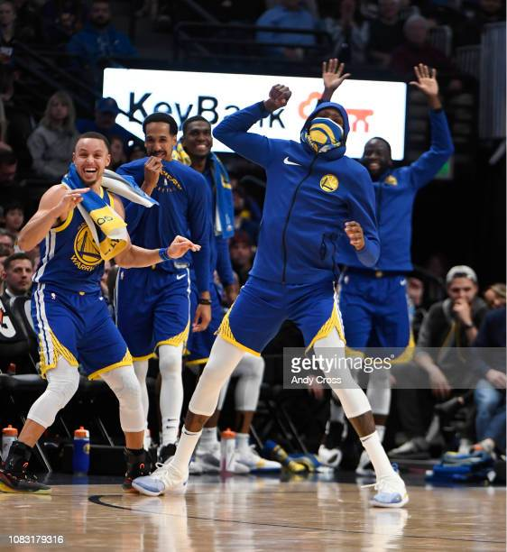 Golden State Warriors guard Stephen Curry , left, and forward Kevin Durant , right, celebrate a dunk by teammate Golden State Warriors guard Klay...