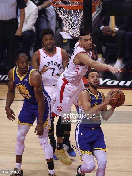 TORONTO ON JUNE 10 Golden State Warriors guard Stephen Curry looks for a way past Toronto Raptors guard Danny Green as the Toronto Raptors lose to...