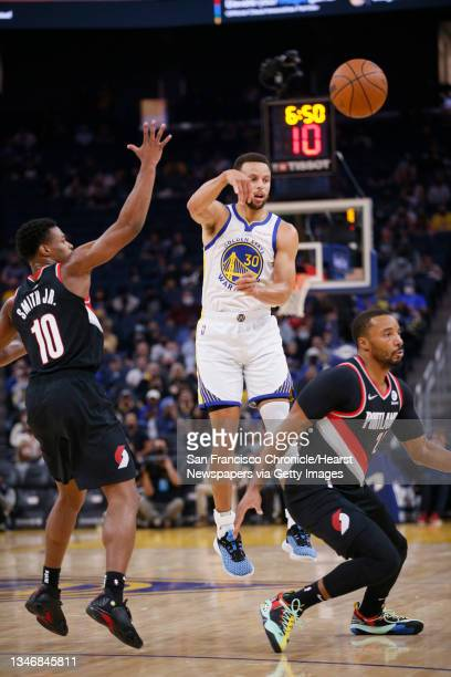 Golden State Warriors guard Stephen Curry passes against the Portland Trail Blazers in the first half of an NBA game at Chase Center, Friday, Oct. 15...