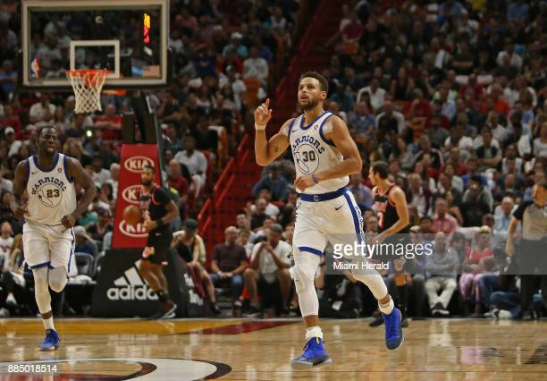 Golden State Warriors guard Stephen Curry reacts after hitting a threepointer against the Miami Heat during the second quarter on Sunday Dec 3 2017...
