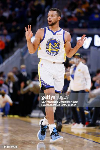 Golden State Warriors guard Stephen Curry reacts after scoring a three-point field goal against the Portland Trail Blazers in the first half of an...