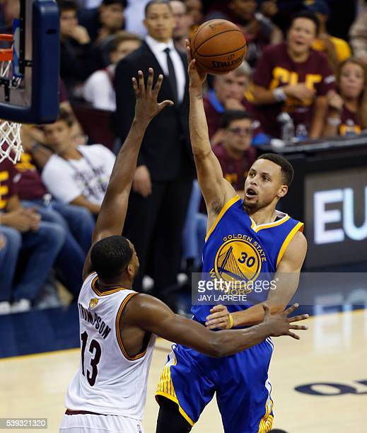 Golden State Warriors guard Stephen Curry shoots over Cleveland Cavaliers forward Tristan Thompson during Game 4 of the NBA Finals in Cleveland Ohio...
