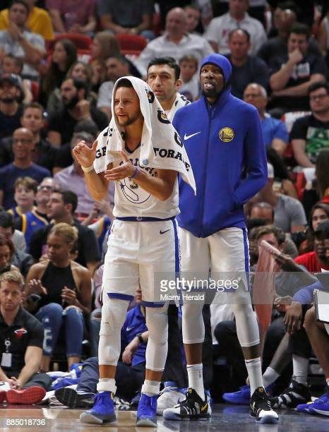 Golden State Warriors guard Stephen Curry shows his support to his teammates during the second quarter against the Miami Heat on Sunday Dec 3 2017 at...