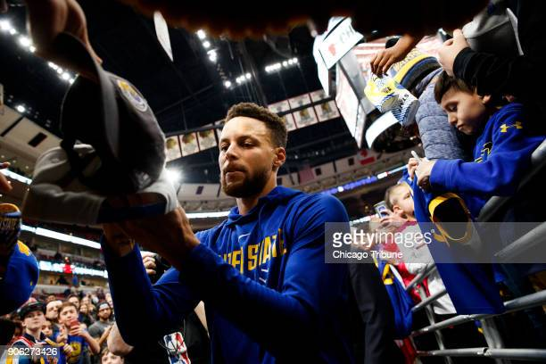 Golden State Warriors guard Stephen Curry signs autographs before the first half against the Chicago Bulls at the United Center in Chicago on...