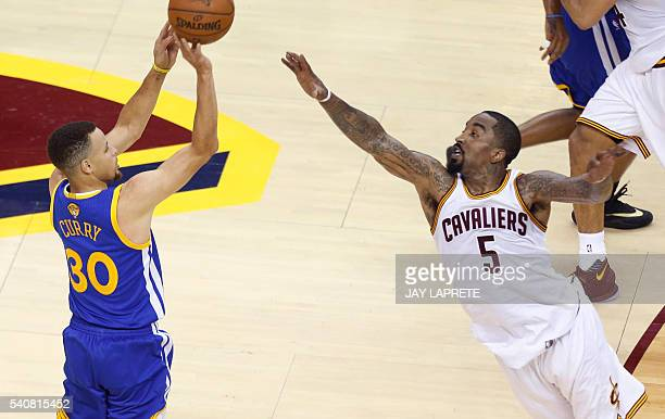 Golden State Warriors guard Stephen Curry takes a shot over Cleveland Cavaliers guard JR Smith during Game 6 of the NBA Finals in Cleveland Ohio on...
