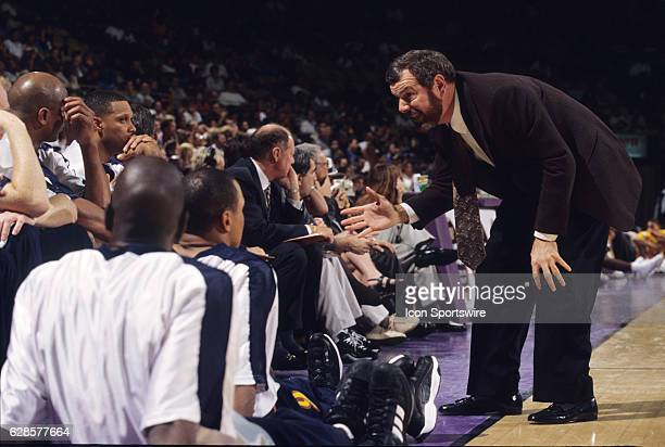 Golden State Warriors head coach PJ Carlesimo speaks to the team during a National Basketball Association game against the Los Angeles Lakers at the...