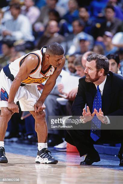 Golden State Warriors head coach PJ Carlesimo talks with Muggsy Bogues during a game played on November 25 1997 at the Arena in Oakland in Oakland...