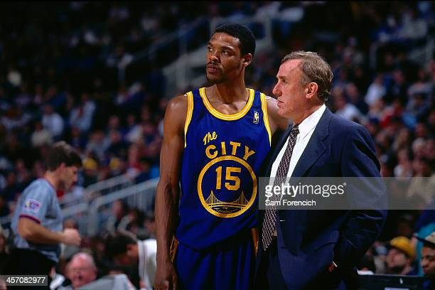 Golden State Warriors head coach Rick Adelman and Latrell Sprewell talk during a game played circa 1997 at the Arena in Oakland in Oakland California...