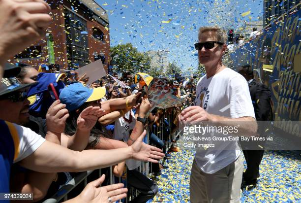 Golden State Warriors head coach Steve Kerr greets the crowd during their championship parade in downtown Oakland Calif on Tuesday June 12 2018 The...