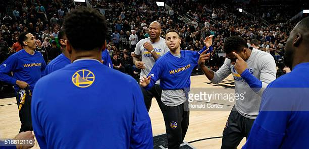 Golden State Warriors including Stephen Curry of the Golden States Warriors do little dance before their game against the San Antonio Splurs at ATT...