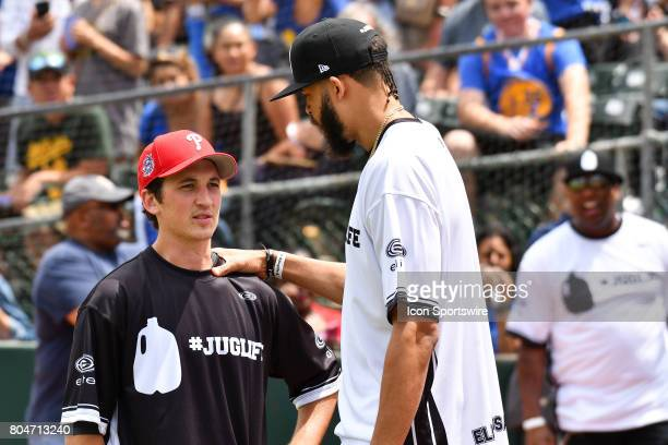 Golden State Warriors JaVale McGee chats with actor Miles Teller during JaVale McGees JUGLIFE charity softball game on June 24 at OaklandAlameda...