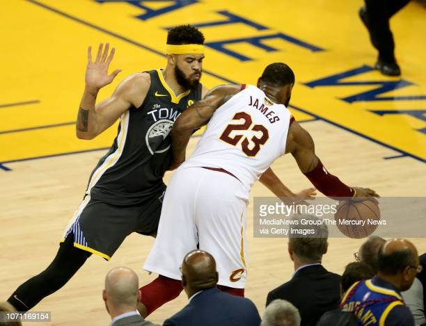 Golden State Warriors' JaVale McGee fouls Cleveland Cavaliers' LeBron James during the third quarter of Game 2 of the NBA Finals at Oracle Arena in...