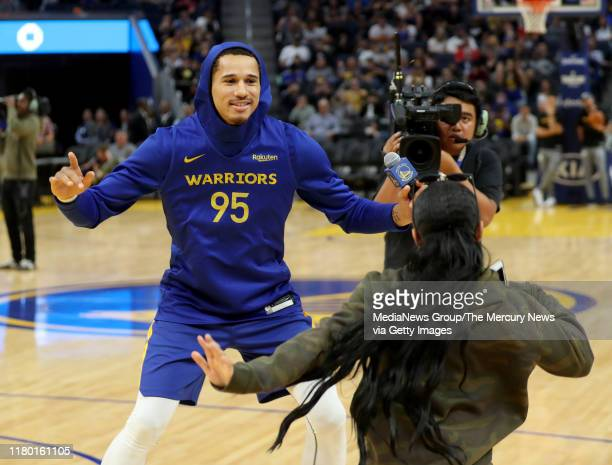 Golden State Warriors' Juan ToscanoAnderson dances with a fan during an open practice at the Chase Center in San Francisco Calif on Monday Oct 7 2019