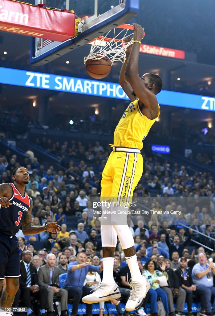c8c2310b6c3 Golden State Warriors  Kevin Durant dunks the ball in the first ...