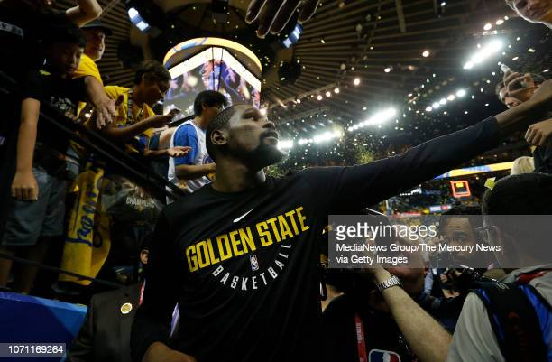 Golden State Warriors' Kevin Durant is congratulated by fans on the way to the locker room after beating the Cleveland Cavaliers 122103 in Game 2 of...