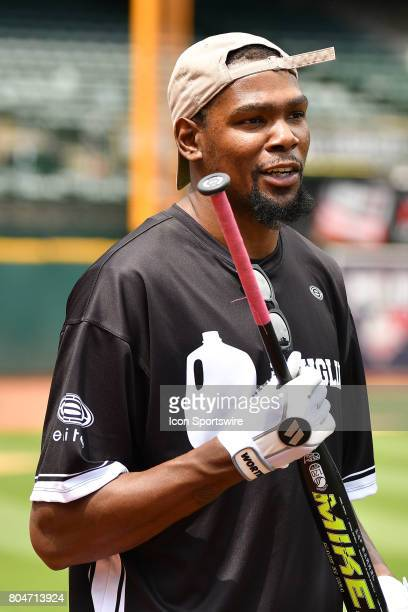 Golden State Warriors Kevin Durant looks on during JaVale McGees JUGLIFE charity softball game on June 24 at OaklandAlameda County Coliseum in...