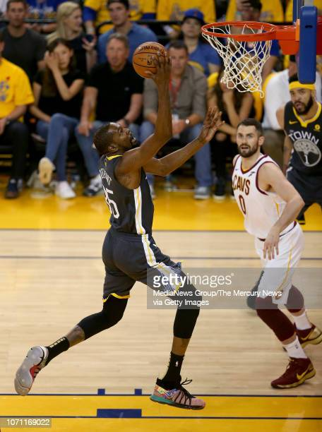 Golden State Warriors' Kevin Durant makes a layup past Cleveland Cavaliers' Kevin Love during the first quarter of Game 2 of the NBA Finals against...