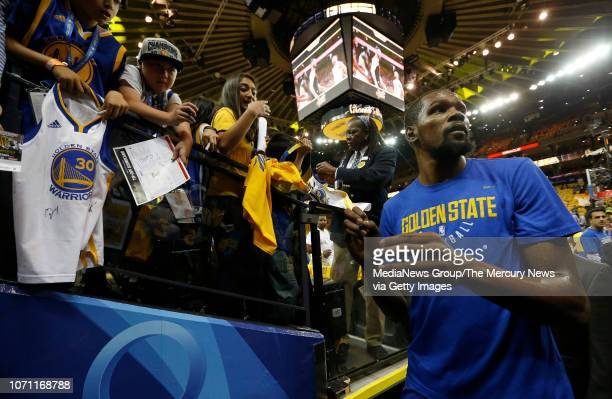 Golden State Warriors' Kevin Durant signs autographs for fans before Game 2 of the NBA Finals against the Cleveland Cavaliers at Oracle Arena in...