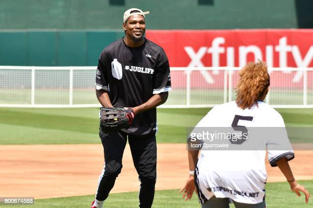 Golden State Warriors Kevin Durant tries to catch Ros Gold Onwude during JaVale McGees JUGLIFE charity softball game on June 24 at OaklandAlameda...