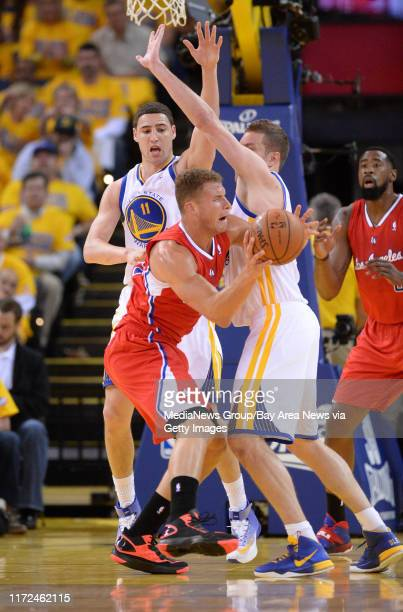 Golden State Warriors' Klay Thompson and Golden State Warriors' David Lee guard against Los Angeles Clippers' Blake Griffin in the first quarter in...