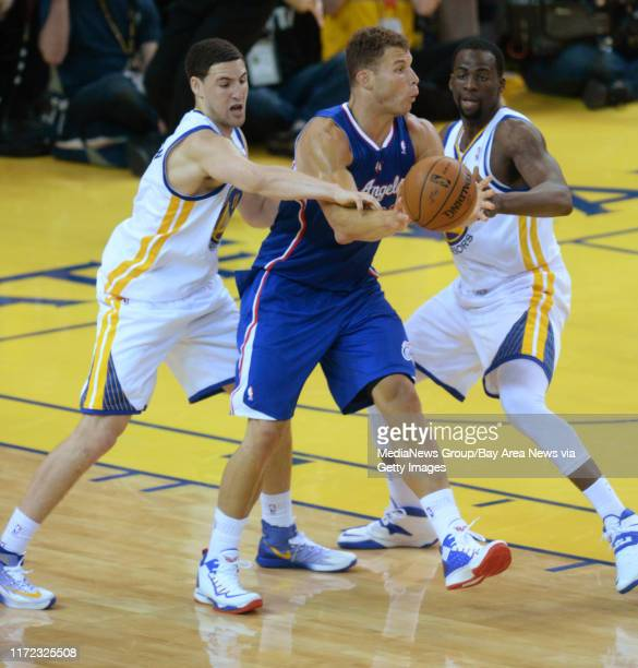 Golden State Warriors' Klay Thompson and Golden State Warriors' Draymond Green guard against Los Angeles Clippers' Blake Griffin in the third quarter...
