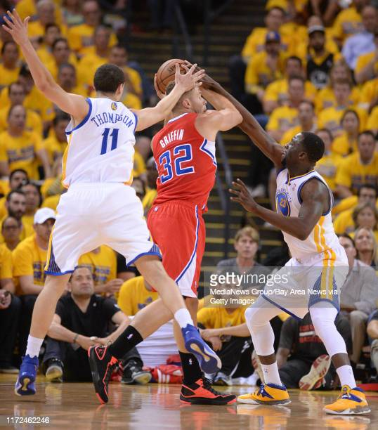 Golden State Warriors' Klay Thompson and Golden State Warriors' Draymond Green guard against Los Angeles Clippers' Blake Griffin in the first quarter...