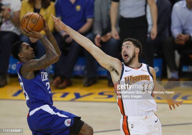Golden State Warriors' Klay Thompson defends against Los Angeles Clippers' Lou Williams in the first quarter at Oracle Arena in Oakland Calif on...