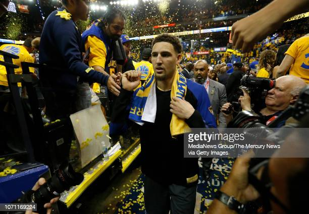 Golden State Warriors' Klay Thompson is greeted by fans on the way to the locker room after beating the Cleveland Cavaliers 122103 in Game 2 of the...