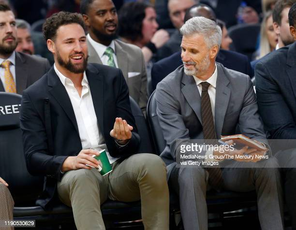 NOVEMBER 25 Golden State Warriors' Klay Thompson sits on the bench with assistant coach Bruce Fraser in the first quarter of their NBA game at the...